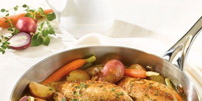 """<p>Chicken breasts, sautéed in a skillet until golden, are finished in the oven with potatoes, onions, carrots, and herbs.</p><br /><p><b>Recipe: <a href=""""/recipefinder/chicken-vegetables-herbs-recipe-campbells-1109"""" target=""""_blank"""">Pan-Sautéed Chicken with Vegetables and Herbs</a> </b></p>"""