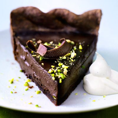 "For the chocolate lover in us all: This densely rich pie is made with a filling of dark chocolate custard nestled in a tender, cocoa-flavored crust. A hint of pistachio helps to offset the sweetness.<br /><br /><b>Recipe: <a href=""/recipefinder/chocolate-pistachio-pie-recipe"" target=""_blank"">Chocolate Pistachio Pie</a></b>"