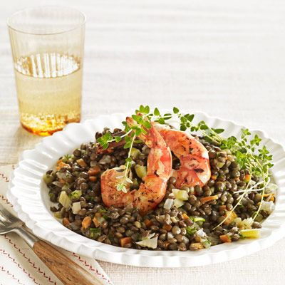 "French lentils — milder than the better-known brown variety, but just as effortless and economical — partner with sautéed shrimp in this slow-simmered seafood supper.<br /><br /><b>Recipe: <a href=""/recipefinder/lentil-salad-shrimp-recipe"" target=""_blank"">Warm Lentil Salad with Seared Shrimp</a></b>"