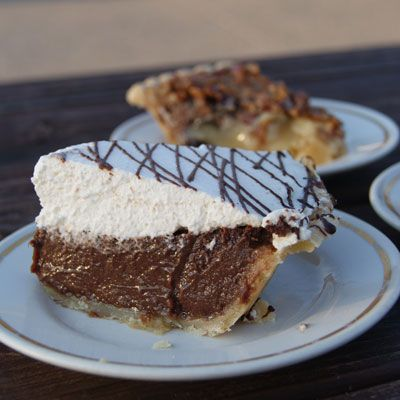 "<p><b>Pie Shop:</b> <a href=""http://www.lovelesscafe.com/"" target=""_blank"">Loveless Cafe</a></p> <p><b>Year Opened:</b> 1951</p> <p><b>Most Popular Pie:</b> All of them!</p> <p>What's the perfect finale to biscuits and fried chicken? Pie, of course! While it's hard to decide which one is truly the standout, the list at the Loveless Cafe includes fudge (pictured), coconut cream, Steeplechase (boubon pecan), and the sinful peanut butter pie in a dark chocolate cookie crust topped with fresh whipped cream. Ready to head to Nashville? If you're not able to get there the Loveless Cafe will be coming out with their first cookbook, <i>Easier Than Pie: Simple Southern Desserts from the Loveless Cafe</i>. We can't wait!</p><br /> <p><b>Try This Recipe:</b> <a href=""http://www.delish.com/recipefinder/chocolate-peanut-butter-moon-pies-recipe-fw0910"" target=""_blank""><b>Chocolate-Peanut Butter Moon Pies</b></a></p>"