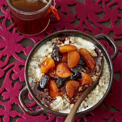 """Stewed with red wine, orange juice, cinnamon, and honey, fragrant apricots and prunes transform a bowl of steel-cut oatmeal into a satisfying winter dish. <br /><br /> <b>Recipe:</b> <a href=""""/recipefinder/red-wine-apricots-prunes-recipe"""" target=""""_blank"""">Red Wine Stewed Apricots and Prunes</a>"""