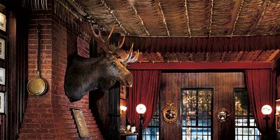 """<p><b>Hot Spot:</b> The Bull Moose Room at <a href=""""http://www.keens.com/"""" target=""""_blank"""">Keens Steakhouse</a>. Established in 1885, Keens was once <i>the</i> gathering place for stage actors, newspapermen, and garment workers. The only remaining relic of New York City's Herald Square Theater District, the Dickensesque restaurant with its famous Mutton Chops, is still the perfect retreat from the busy Manhattan streets and brisk winter winds.</p> <p><b>Coziest Dish:</b> Prime Rib Hash. Sauteed potatoes, onions, and chopped <a href=""""http://www.delish.com/recipefinder/three-ingredient-prime-rib-roast-recipe"""" target=""""_blank"""">prime rib</a> roast formed into a patty, crisped in the pan and served with a sunnyside up egg.</p> <p><b>Winter Warming Drink:</b> Irish Coffee. This cup 'o joe with a kick has been prepared at the bar for over a century. A heated glass is filled with hot coffee, sugar, Jameson Irish whiskey, and finished with a decadent dollop of fresh whipped cream.</p>"""