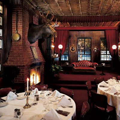 "<p><b>Hot Spot:</b> The Bull Moose Room at <a href=""http://www.keens.com/"" target=""_blank"">Keens Steakhouse</a>. Established in 1885, Keens was once <i>the</i> gathering place for stage actors, newspapermen, and garment workers. The only remaining relic of New York City's Herald Square Theater District, the Dickensesque restaurant with its famous Mutton Chops, is still the perfect retreat from the busy Manhattan streets and brisk winter winds.</p> <p><b>Coziest Dish:</b> Prime Rib Hash. Sauteed potatoes, onions, and chopped <a href=""http://www.delish.com/recipefinder/three-ingredient-prime-rib-roast-recipe"" target=""_blank"">prime rib</a> roast formed into a patty, crisped in the pan and served with a sunnyside up egg.</p> <p><b>Winter Warming Drink:</b> Irish Coffee. This cup 'o joe with a kick has been prepared at the bar for over a century. A heated glass is filled with hot coffee, sugar, Jameson Irish whiskey, and finished with a decadent dollop of fresh whipped cream.</p>"