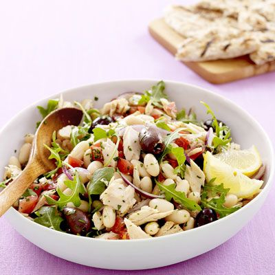 """<p>Stock up on items that have a long shelf life, like canned goods, pasta, and grains. They're usually a bit more inexpensive, and you can often find great deals when buying in bulk. The next time you're in a bind, try our <a href=""""http://www.delish.com/recipefinder/tuna-white-bean-salad-rbk """"target=""""_new"""">Tuscan Tuna and White Bean Salad</a> (pictured), <a href=""""http://www.delish.com/recipefinder/vegetable-lasagna-toss""""target=""""_new"""">Vegetable Lasagna Toss</a>, or <a href=""""http://www.delish.com/recipefinder/new-orleans-rice-beans-2397 """"target=""""_new"""">New Orleans-Style Rice and Beans</a>. You'll already have what you need to whip up a fast dinner, so no more ordering takeout!</p>"""