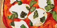 """This classic Italian pizza is made with fresh mozzarella and hand-torn basil leaves. <br /><br /> <b>Recipe:</b> <a href=""""/recipefinder/margherita-pizza-clv0108"""" target=""""_blank"""">Margherita Pizza</a>"""
