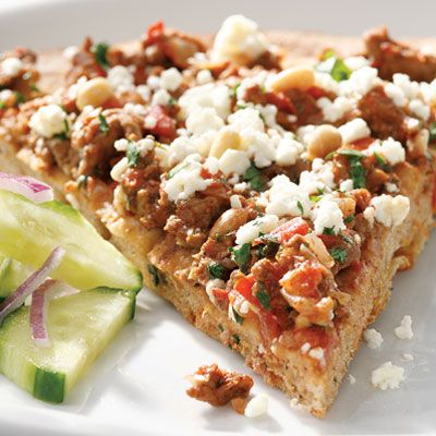 "<p>Spiced ground lamb, feta, and pine nuts top this Armenian-flavored pizza.</p><br /> <p><b>Beer Pairing:</b> Break out the stout — the rich, sweet flavors from the lamb and pomegranate molasses yearn for an equally rich, sweet beer.</p><br /> <p><b>Recipe: </b><a href=""/recipefinder/lahmahjoon-pizza-recipe-9896"" target=""_blank""><b>Lahmahjoon Pizza</b></a></p>"