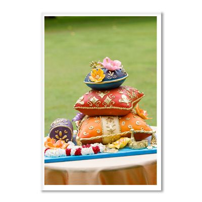<p>Rick Reichart, who co-owns cakelava with his wife, Sasha, designed this colorful sculpted-pillow wedding cake with handcrafted accent pieces for a yoga instructor's tropical wedding.   