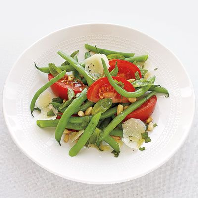 """Fresh green and yellow beans add crisp crunch and colorful flavor.<br /><br /> <b>Recipe: <a href=""""/recipefinder/green-beans-tomatoes-mint-pine-nuts-recipe""""target=""""_new"""">Green Beans with Tomatoes, Mint, and Toasted Pine Nuts</a></b> (pictured) <b></b><br /><br /> <b>More Recipes: <br /> <a href=""""/recipefinder/green-yellow-beans-salad-recipe""""target=""""_new"""">Green and Yellow Beans Salad</a><br /> <a href=""""/recipefinder/green-bean-potato-salad-recipe""""target=""""_new"""">Green Bean Potato Salad</a> </b>"""