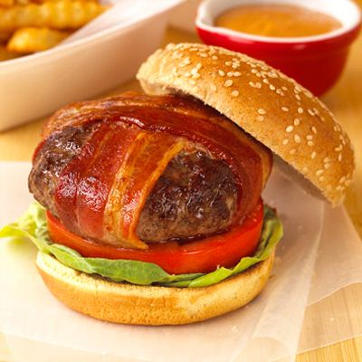 "<p>Perfect beef patties (not too thick and not too thin) are graced with smoky, crisp bacon and all the fresh fixins to make the classic malt shop hamburger. By 1960, Ray Kroc had opened more than 200 McDonald's restaurants, bringing the burger fad to a fevered frenzy.</p><br /><p><b>Recipe: <a href=""/recipefinder/BLT-Burgers"" target=""_blank"">BLT Burgers</a></b></p>"