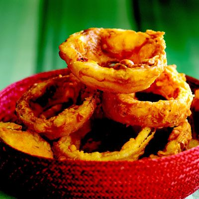 "<p>Fried sides were not always limited to potatoes. Enter the full-flavored riff on the classic burger accompaniment: onion rings! Golden and puffed with that unmistakable tang, batter-fried onion rings add something special to a malt shop meal.</p><br /><p><b>Recipe: <a href=""/recipefinder/buttermilk-onion-rings-recipe"" target=""_blank"">Buttermilk Onion Rings</a></b></p>"