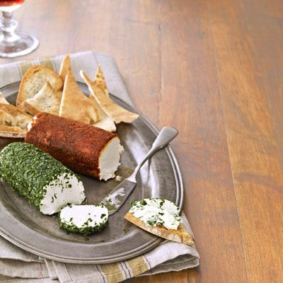 "Our fresh take on the cheese ball comes with an added bonus: The log shape allows guests to slice, rather than dig, into the appetizer.<br /><br /><b>Recipe: <a href=""/recipefinder/goat-cheese-logs-recipe"" target=""_blank"">Goat Cheese Logs</a></b>"