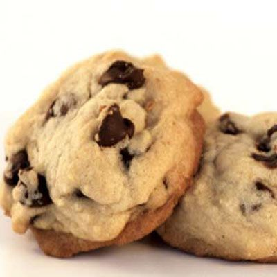 """A simple cooking error led to the creation of the now-classic Nestlé Toll House Chocolate Chip Cookie. In 1930, Ruth Wakefield, who ran the Toll House Inn in Massachusetts, added chopped pieces of a semi-sweet chocolate bar to her Butter Drop Do cookie dough, expecting the chunks to melt. But the chocolate only softened and held its shape. The cookies were a hit at her inn. Eventually Ruth's recipe was published in a Boston newspaper and ended up on the wrapper of the Nestlé semi-sweet chocolate bar.<br /><br /> Check out these <a href=""""/search/fast_search_recipes/?search_term=chocolate chip cookies"""" target=""""_blank""""><b>chocolate chip cookie recipes</b></a>."""