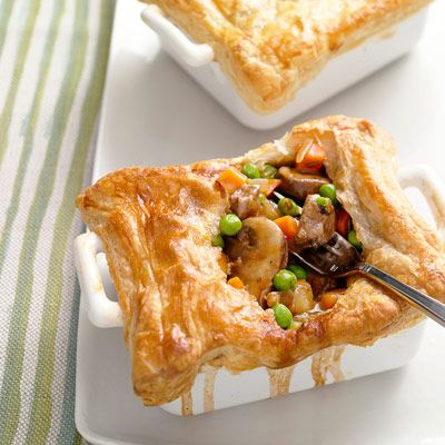 "Golden puff pastry covers a hearty stew-like mixture of beef, mushrooms, and veggies in these individual-sized potpies.<br /><br /><b>Recipe: <a href=""/recipefinder/steak-mushroom-pot-pie-recipe"" target=""_blank"">Steak and Mushroom Potpies</a></b>"