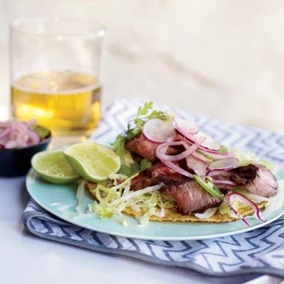 "<b>Tomorrow:</b> These tostadas (a close cousin to tacos) use the leftover and pregrilled <a href=""/recipefinder/spice-rubbed-t-bone-steaks-recipe-fw0610"" target=""_blank""><b>Spice-Rubbed T-Bone Steaks</b></a> sliced thin. Topped with a crunchy radish salad and piled on crispy tortillas, the steak takes on new life.<br /><br /><b>Recipe:</b> <a href=""/recipefinder/grilled-t-bone-tostadas-spicy-radish-salad-recipe-fw0610"" target=""_blank""><b>Grilled T-Bone Tostadas with Spicy Radish Salad</b></a>"