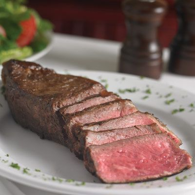 "<p>After eighty years, the original Palm — not so much its twenty-eight branches from San Juan to West Hollywood — still serves the finest of all cuts: the New York strip, on the bone, seared, broiled in a 1600-degree oven, caked with a perfectly smoky char every time. The place hasn't lost its raffishness from the days when cartoonists paid for food by decorating the walls. <i>(<a href=""http://www.thepalm.com/"" target=""_blank"">Palm Restaurant</a>; 837 Second Avenue, New York, NY; 212-687-2953)</i> </p><br /> <b>Try This At-Home Recipe:</b> <a href=""/recipefinder/skillet-roasted-strip-steaks-pebre-sauce-avocado-recipe-9425"" target=""_blank""><b>Skillet-Roasted Strip Steaks</b></a></p>"