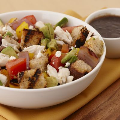 """<b>Submitted by:</b> <a href=""""/rf/user/watkinsp/recipebook"""" target=""""_blank""""><b>watkinsp</b></a><br /><br />The classic Italian bread salad gets a makeover by throwing ciabatta bread, onions, and peppers on the grill before tossing with tomatoes, crab meat, and avocado. And a zesty Dijon-balsamic vinaigrette and crumbled goat cheese finish it all off.<br /><br /><b>Recipe:</b> <a href=""""/recipefinder/Grilled-Panzanella-S-FD92DBAA816D11DFA19B67B043BDAD0B"""" target=""""_blank""""><b>Grilled Panzanella Salad</b></a>"""
