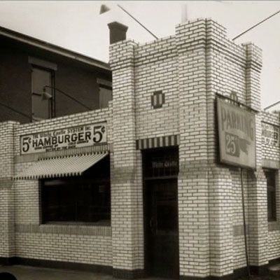 "<p><b>Year Opened:</b> 1921</p> <p><b>First Location:</b> Wichita, KS </p> <p><b>Bite of History:</b> The very first White Castle opened its doors on just $700. Founder Billy Ingram sold his slider-style burgers at the bargain price of five cents per patty and, over the years, the chain prided itself on offering affordable food. By 1941, White Castle had sold more than 50 million burgers, and it wasn't until 1950 that the price made it past the 10-cent mark. In 2011, the famous drive-in known for its five-hole burger — which the company maintains cooks the patties ""faster and more evenly"" — will celebrate its 90th anniversary.</p>"