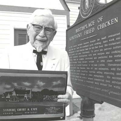 <p><b>Year Opened:</b> 1930 </p><p><b>First Location:</b> Corbin, KY</p><p><b>Bite of History:</b>  Harland Sanders's first outpost of Kentucky Fried Chicken, Sanders Court and Café, was located in the front room of a local gas station in Corbin, Kentucky. Word spread quickly that Sanders's special recipe for fried chicken cooked in an iron skillet was finger-lickin' good. The only issue: The more popular the restaurant, the harder it was to meet the demand. Not wanting to compromise quality, Sanders sought out a way to cut time without sacrificing flavor. After seeing a demo for the latest gadget — the pressure cooker — Sanders tweaked his process, and to this day, KFC's Original Recipe is always fried under pressure.</p>