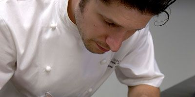 """<a href=""""http://www.perennialchicago.com/"""" target=""""_blank"""">Perennial</a> chef Ryan Poli favors Roman-style <a href=""""/recipes/cooking-recipes/gnocchi"""" target=""""_blank"""">gnocchi</a>, which he makes by stirring semolina on the stove in an indulgent mix of black-truffle broth, chopped truffles, truffle oil and a little Parmesan butter. Once the semolina firms up, Poli cuts it into precise squares and fries them until they're crisp on the outside, but still creamy inside ($12).<br /> —<i>Tina Ujlaki</i>"""