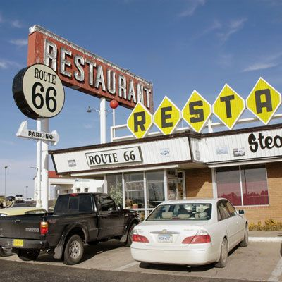 "<p><b>Pit Stop:</b> Route 66 Restaurant, 2295 Historic Route 66 (1819 Will Rogers Drive), Santa Rosa, NM, (575) 472-9925</p><br /><p>Stretching nearly 2,500 miles from Chicago to Los Angeles, John Steinbeck coined this famous highway ""Mother Road."" When you're in New Mexico, get your kicks at the eponymous Route 66 Restaurant in Santa Rosa.</p><p><b>Road Tip:</b> Go for local Southwest flavors with an order of <a href=""http://www.delish.com/recipefinder/huevos-rancheros-2940"" target=""_blank""><b>Huevos Rancheros</b></a>.</p>"