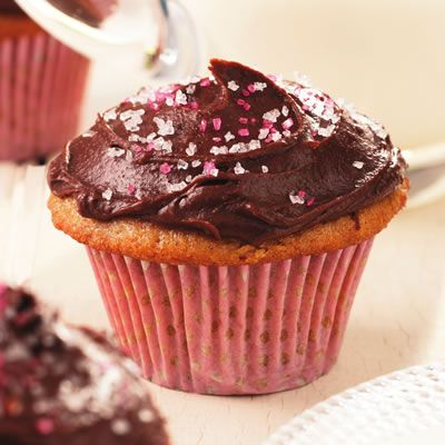 "<p>These vanilla-infused cupcakes are made with applesauce as a fat-replacer for the butter that's traditionally part of vanilla cake batter. Thickened evaporated milk works as a great base for the rich and creamy chocolate frosting. Dark chocolate lovers, be sure to use bittersweet chocolate. </p><br /><p><b>Recipe:</b> <a href=""/recipefinder/vanilla-cupcakes-chocolate-frosting-recipe-ew0610""><b>Vanilla Cupcakes with Chocolate Frosting</b></a></p>"