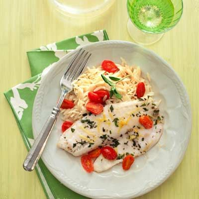 "<p>This healthy Mediterranean fish dish boasts fresh oregano leaves, grape tomatoes, and orzo. Sounds pretty perfect.</p><br /> <p><b>Recipe: </b><a href=""/recipefinder/greek-style-tilapia-recipe"" target=""_blank""><b>Greek-Style Tilapia</b></a></p>"