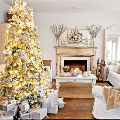 An all-white home in British Columbia becomes a holiday haven with glittery decorations and a shimmering tree.
