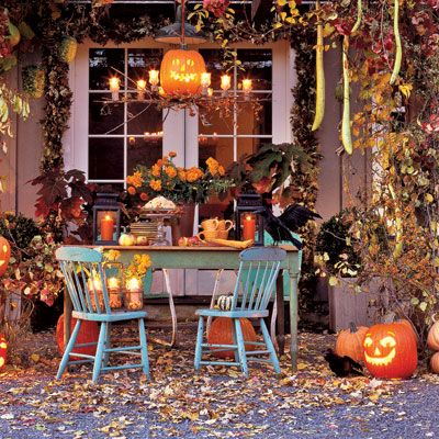 "SETTING THE SCENE: Come October, often you can still host a party outdoors. Just let fall's exuberant palette lend a hand with the decorating, suggest Richard Kollath and Ed McCann, who like to layer in atmospheric Halloween accents when entertaining. The designers, authors, and event planners (their most recent book is <i>Faux Flowers</i>&#x3B; Chronicle Books) advise: ""Host a party for adults or families the week before Halloween, then leave the decorations up for trick-or-treaters."" You also have a great excuse not to sweep up the leaves, which, scattered across the ground, help set the scene. Autumn foliage, faux crows, candlelight, and plenty of jack-o'-lanterns cast a welcoming spell on an outdoor dessert buffet.<br /><br /><b>Pictured:</b> On the back terrace, branches of autumn leaves, bittersweet berries, and hanging gourds create a lush frame for a help-yourself dessert buffet.<br /><br /><i>PLATES, NAPKINS: THE WELL-SEASONED NEST. MUGS: POTLUCK STUDIOS.</i>"