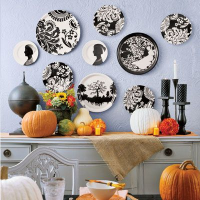 Start with a simple Halloween-inspired palette, add a dash of mischievous fun, then host a memorable dinner party. Graphic black-and-white plates and trays are the highlight of an autumn vignette. Affix them to the wall with Fun-Tak adhesive. A few fun and playful elements will spark conversation.