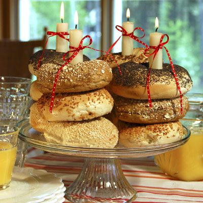 Have an early-morning birthday celebration with bagels or plain doughnuts instead of sugary cupcakes. Stack bagels atop a cake plate and place taper candles within each stack. Alternating pumpernickel and egg bagels or sesame and poppy can create colorful patterns. To ensure that the candles stay upright and don't lean on the bagels or doughnuts, drip some melted wax on the plate to use as an anchor. Festive ribbons add the final touch; just be sure to blow out the flames before they get too close!
