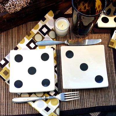 Score big at your next game night with these fun appetizer plates. Use two at each setting to replace a normal-sized plate. Continue the casino and gaming theme with matching geometric napkins. Not all casinos are created equal: Make sure yours is five stars with small votives and reed place mats.