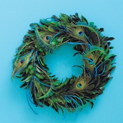 <b>...adds regal glamour to a door or room.</b><br />  (Find peacock feathers like these at <i>jamaligarden.com</i>.)