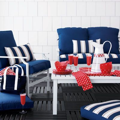 """Use a distinct color theme — here, it's patriotic reds, whites, and shades of blue — to give your backyard party a boost of style. <br /><br /><b>Tip:</b> When you're entertaining outdoors, the rule of thumb is to keep it casual — so don't fret if you have only six chairs. Just plop extra outdoor pillows on the deck, and everyone will have a cushy seat.  <br /> <br /> <b>West Hampton seating collection</b> in white, $999 for 5-piece set, Levitz, <a href=""""http://www.levitz.com/""""target=""""_new"""">levitz.com</a>. <br /><b>Antiqued French pitcher</b>, $28, Vagabond Vintage, <a href=""""http://www.mothology.com/""""target=""""_new"""">mothology.com</a>. <br /><b>Spot red melamine plates and bowls</b>, each $31 for set of 4&#x3B; <b>Multi star and spot paper cocktail napkins</b>, each $6&#x3B; <b>New Star red tea towels</b>, $10 each&#x3B; <b>New Star red oilcloth</b>, $31 per yard (make any size tablecloth you need!): all from Cath Kidston, <a href=""""http://www.cathkidston.com/""""target=""""_new"""">cathkidston.com</a>. <br /><b>Precidio 10-oz Belle Flute</b>, $4, 800-387-2304."""
