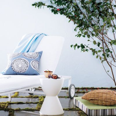 """<b>Lounger</b>, $279, and cushion, $99, <a href=""""http://www.westelm.com/products/g082/?pkey=coutdoor-patio-furniture"""" target=""""_blank"""">westelm.com</a>. <br /> <b>Pillow cover</b>, $34, <a href=""""http://www.westelm.com/products/r893/?pkey=x%7C4%7C1%7C%7C6%7Cpillow%20cover%7C%7C0&cm_src=SCH"""" target=""""_blank"""">westelm.com</a>. <br /> <b>Live Brown Porcelain tiles with slip-resistant surface</b>, $16 per square foot (tiles are 16x16 inches), Artistic Tile, <a href=""""http://www.artistictile.com/"""" target=""""_blank"""">artistictile.com</a> for retailers. <br /> <b>Prince Aha stool/table</b>, $110, <a href=""""http://hivemodern.com/pages/products.php?view=sub_product&sid=389"""" target=""""_blank"""">hivemodern.com</a>. <br /> <b>Bamboo Mini-Me bowl in natural</b>, $12, Bambu, <a href=""""http://www.bambuhome.com/"""" target=""""_blank"""">bambuhome.com</a> for stores. <br /><b>20-inch decorative pillow</b>, $55, <a href=""""http://www.spiegel.com/shop/product_single.aspx?style_id=35900284"""" target=""""_blank"""">spiegel.com</a>. <br /> <b>Blue beach towel from ABH designs</b>, $55, 212-249-2276. <br /> <b>Old Navy sunglasses</b>, $9.50, <a href=""""http://oldnavy.gap.com/browse/search.do?searchText=sunglasses&searchDivName=Women&submit.x=0&submit.y=0"""" target=""""_blank"""">oldnavy.com</a>."""