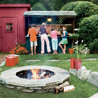 """Summer's carefree tenor invites us to spend more time outdoors, particularly when entertaining. Create just the right ambience for a backyard party with these inground and above-ground fire pits and other great ideas for customizing an outdoor dining area. <br><br>GATHER 'ROUND: The ongoing trend toward outdoor living and entertaining is a natural extension of our choice to enjoy more time at home. In summertime, relaxed, simple get-togethers are more appealing than the more formal kinds of dinner parties often associated with colder weather. Increasingly, homeowners are investing in outdoor kitchens and dining rooms, with the notion that these outdoor """"rooms"""" can be used beyond the summer months. Adding a fire pit is one way to extend the season, warming up the chill of an early summer evening or a crisp fall day. The inviting flames encourage guests to gather 'round, toast marshmallows, and maybe linger a little longer in the company of good friends."""