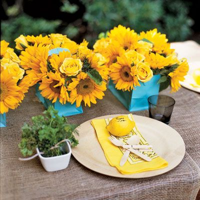 A refreshing palette of golden yellow and robin's-egg blue sets the scene. For a casual yet stylish affair, mix upscale elements with down-home details. Burlap, bandannas, and disposable pleats mingle effortlessly with fresh flowers and herbs.