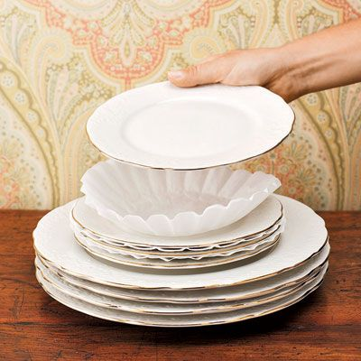 "To protect your fine china while it's in storage, try placing coffee filters between the dishes. ""I'm always looking for inexpensive solutions to common problems,"" says <i>Country Living</i> decorating editor Frances Bailey. ""Why not use what's most handy?"""