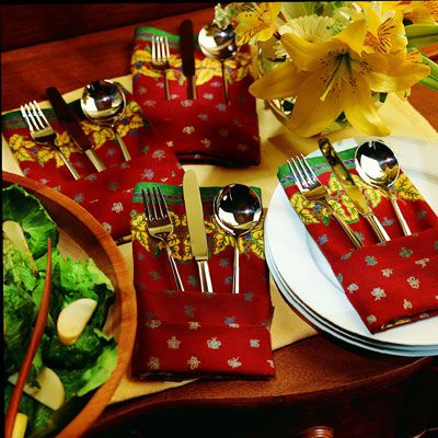 <p>Napkin and flatware are artfully presented together in this clever fold.</p><br />
