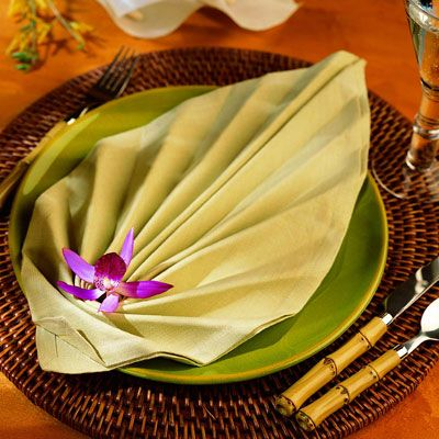 <p>Use a generous amount of starch to keep the folds crisp.</p><br /> <p>Keep an iron nearby so you can sharply press the folds as you work.</p><br /><p>Lay the folded napkin across the plate or stand it on the broad end.</p><br />