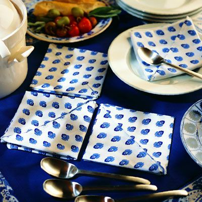 <p>To save precious space, simply stack the folded pockets at the end of the table.</p><br /><p>A quilt-like array of folded napkins also makes an attractive presentation.</p><br />