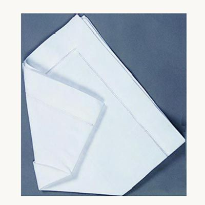 <p>Turn the napkin over.</p><br /><p>Fold in the left side at a slight angle.</p><br />