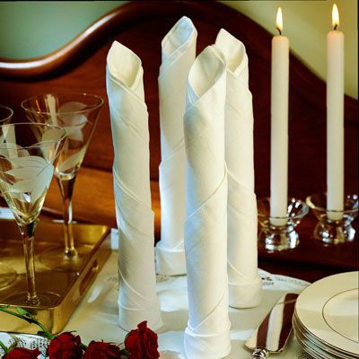 <p>To imitate the shape of a taper candle, roll your napkin and place it upright at the table or buffet.</p><br />