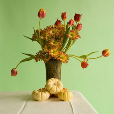 <b>Flower Arranging Techniques From A Pro</b> <br><br> 1. QUICK COLOR: Fill vases with cranberries or kumquats, then add water and flowers in complementary shades, says New York City floral designer Remco van Vliet. <br><br> 2. NICE AND EASY: If you're on a budget, Remco recommends arranging inexpensive poppies, daisies, or dahlias in old milk bottles or tumblers down the center of your table. <br><br> 3. EYE-TO-EYE: To ensure guests can converse freely, flowers should sit no taller than 14 inches, says Remco.