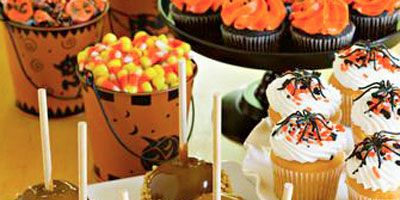 """<p>Before whipping up a batch of our favorite caramel apples, place bowls of gummy spiders (available at <a href=""""http://www.carolscandycorner.com"""" target=""""_new"""">Carol's Candy Corner</a>), chopped nuts, candy corn, sprinkles, mini-M&Ms, coconut, chocolate chips, raisins, and other apple-worthy additions in small bowls around a table. While the caramel on your completed apples is still warm (but not hot), pass them out to your little devils and have them create their own custom caramel apples.</p> <br /> <p><strong>RECIPES:</strong><br /> <a href=""""/recipefinder/caramel-candied-apples-3122"""" target=""""_blank""""><b>Caramel Candied Apples</b></a><br /> <a href=""""/recipefinder/outrageous-caramel-apples-855"""" target=""""_blank""""><b>Outrageous Caramel Apples</b></a></p><br />"""
