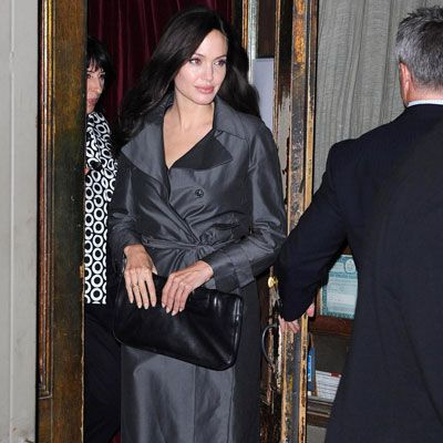 Angelina Jolie enjoyed a private dinner at New York's famed Italian restaurant Il Buco to celebrate the release of her new film, <i>The Changeling</i>. Could rumors of her pregnancy be true? Looks like Jolie <i>is</i> doing the old bag over the belly trick.