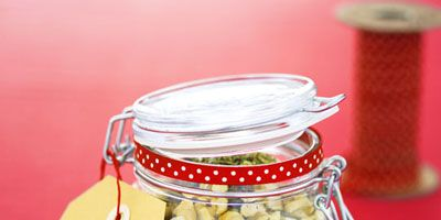 """<p>Dried lentils and seasonings are layered into a beribboned mason jar to create this inexpensive, one-of-a-kind holiday gift.</p><br /> <p>Check out our <a href=""""/recipefinder/curried-lentil-soup-december-recipes"""" target=""""_blank"""">Curried Lentil Soup Recipe</a> for complete instructions.</p>"""