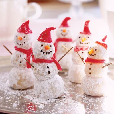 You can whip up these mini men in minutes. Roll pieces of marzipan into balls and dip them into confectioners' sugar; connect with toothpicks. Use marzipan dyed red to shape the hat and scarf and dyed orange for the nose. Finishing touches: brown toothpick arms and tiny chocolate chips for the eyes, mouth, and buttons.