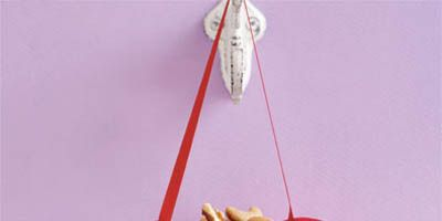 """Holiday treats look almost too good to eat in adorable baskets you can make yourself out of heavy construction paper or  felt.<br /><br /><a href=""""http://www.delish.com/entertaining-ideas/holidays/valentines-day-recipes/heart-basket-crafts-020309"""" target=""""_blank"""">Get step-by-step instructions to make this basket</a>."""