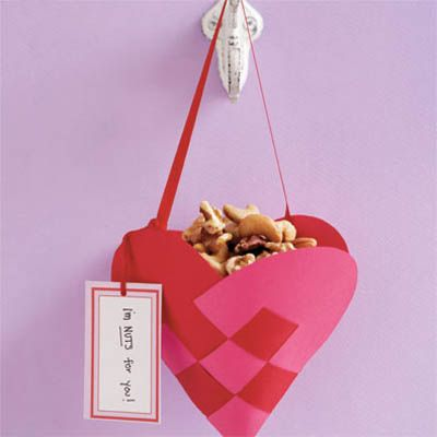 "Holiday treats look almost too good to eat in adorable baskets you can make yourself out of heavy construction paper or  felt.<br /><br /><a href=""http://www.delish.com/entertaining-ideas/holidays/valentines-day-recipes/heart-basket-crafts-020309"" target=""_blank"">Get step-by-step instructions to make this basket</a>."