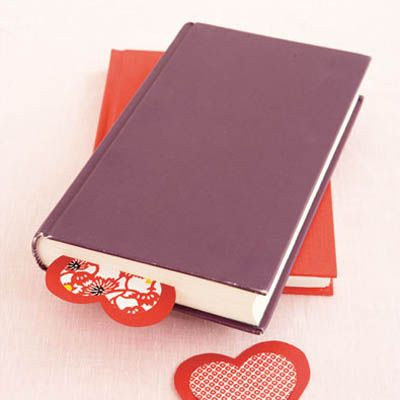 <p>Let a beloved reader know how much you care with this easy valentine.</p><br />  <p>Draw and cut out a heart-shaped template about 3 inches wide and trace it onto brightly colored card stock. Next, photocopy the template at 80 percent. Trace this smaller heart onto something festive-looking — origami paper, for instance, or a pretty card from last year. Cut out both hearts, center the smaller heart on top of the larger one and paste them together with a glue stick. When the glue is dry, use a utility knife to carefully cut around the edge of the bottom half of the smaller heart and through the card stock underneath. Your favorite bookworms can then simply slip a page between the hearts to hold their place in a book.